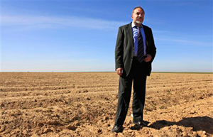 "Israel's new foreign minister, Avigdor Lieberman, stands in a field just outside the Gaza Strip. Lieberman's right-wing Yisrael Beiteinu Party had an impressive showing in Israel's recent election, campaigning with the slogan ""Without loyalty, there is no citizenship."""