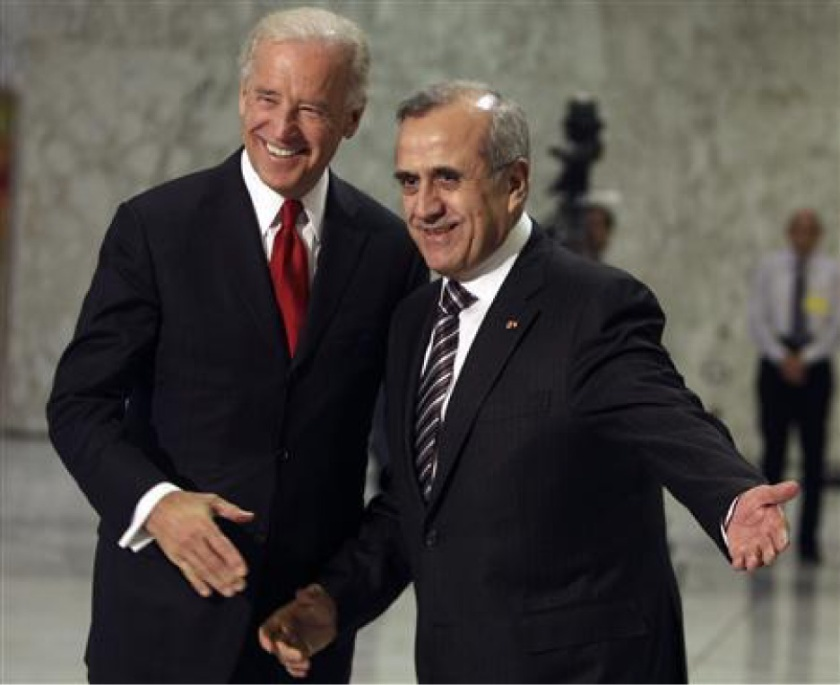 Lebanon's President Michel Suleiman (R) gestures as he welcomes U.S. Vice President Joe Biden at the presidential palace in Baabda, near Beirut, May 22, 2009.  REUTERS/ Mohamed Azakir