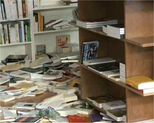 Librairie Resistances - scene of the damage; books doused with oil