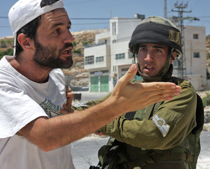 "Kobi Snitz: ""Even ten Israelis at a demonstration can make a real difference. We know from the army's own declarations that their open fire regulations change as soon as they think there are Israelis around."""
