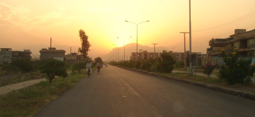 Beyond Hayatabad, the sun sets over the Khyber hills which separate Peshawar from the Federally Administered Tribal Areas (FATA). The Pakistani Army is at present conducting a military opertion in the Khyber Agency.