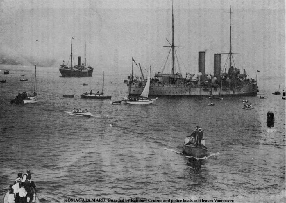 """""""Komagata Maru: Guarded by Rainbow Cruiser and police boats as it leaves Vancouver""""  Uncredited Photo at: http://gadar.homestead.com/GadarHist.html"""