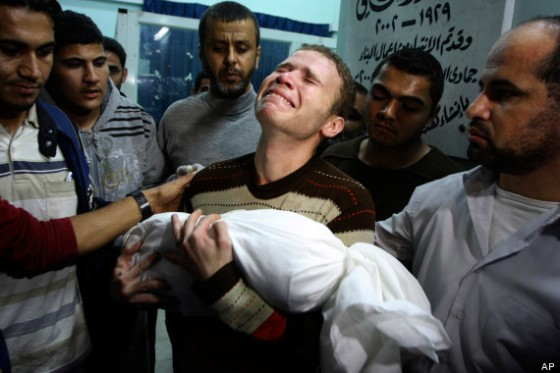 BBC journalist Jihad Masharawi carries his son's body at a Gaza hospital. (Associated Press)