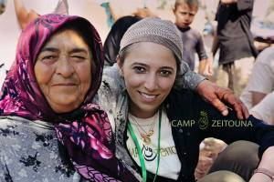 Lina Sergie Attar with a woman from rural Idlib, Atmeh camp, Syria. photo by Mohamed Ojjeh