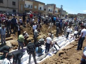 AFP photo. burying victims of the Houla massacre