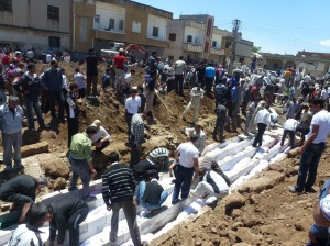 AFP photo. burying victims of the Houla massacre
